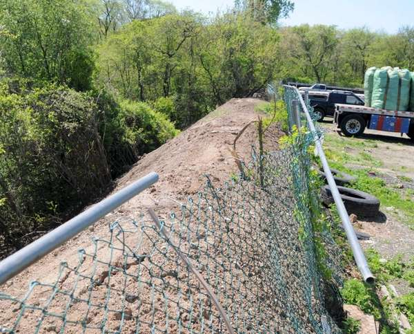 A 300-foot berm of debris seen Monday morning