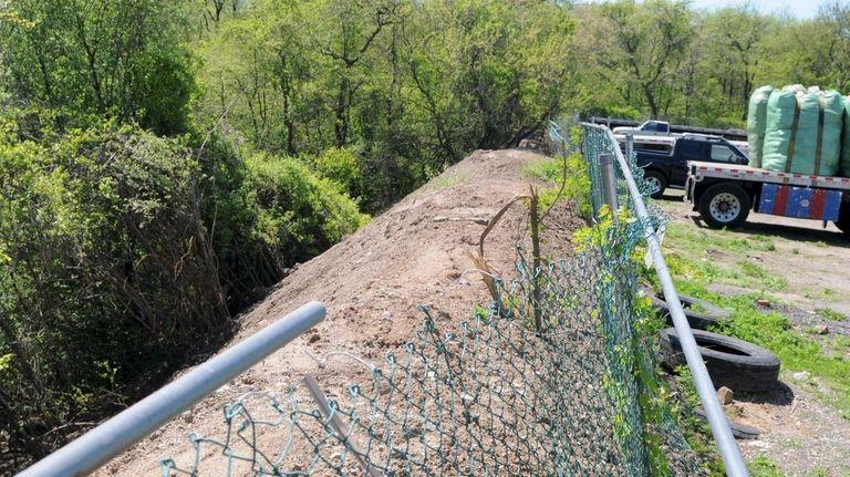 A 300-foot berm of debris seen Monday morning