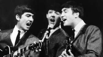 George Harrison, Paul McCartney and John Lennon perform