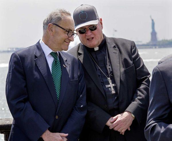 New York Cardinal Timothy Dolan speaks with Sen.