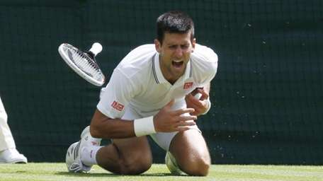 Novak Djokovic of Serbia shouts in pain after