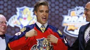 Aaron Ekblad pulls on a Florida Panthers sweater