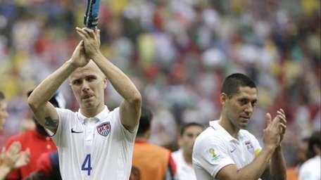United States' Michael Bradley, left, and Clint Dempsey