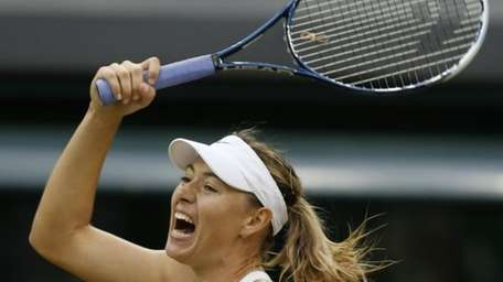 Maria Sharapova reacts after she played a return