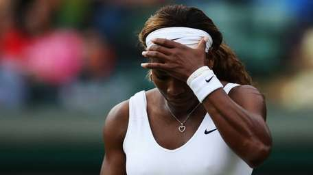 Serena Williams of the United States stands dejected