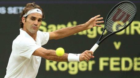 Switzerland's Roger Federer returns against Colombia's Santiago Giraldo