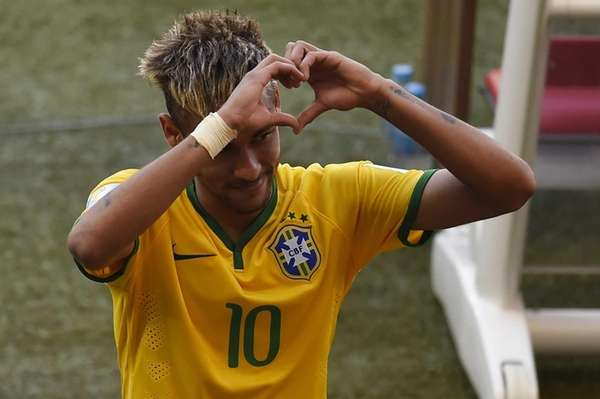 Brazil's forward Neymar gestures towards the fans as