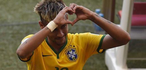 Brazil's forward Neymar gestures towards the fans as