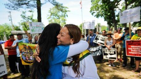 Denisse Giron, of Uniondale, left, and Marcy Suarez,