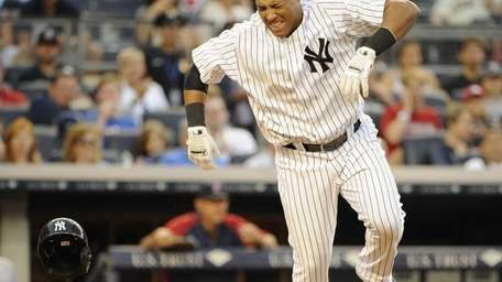 Yankees' Yangervis Solarte reacts after he is hit