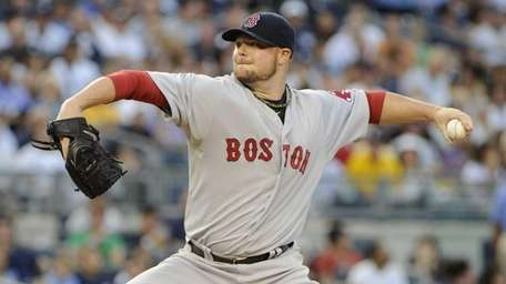 Boston Red Sox starting pitcher Jon Lester delivers