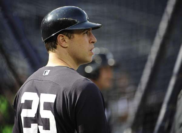 Yankees Mark Teixeira looks on during batting practice