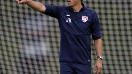 United States head coach Jurgen Klinsmann talks to