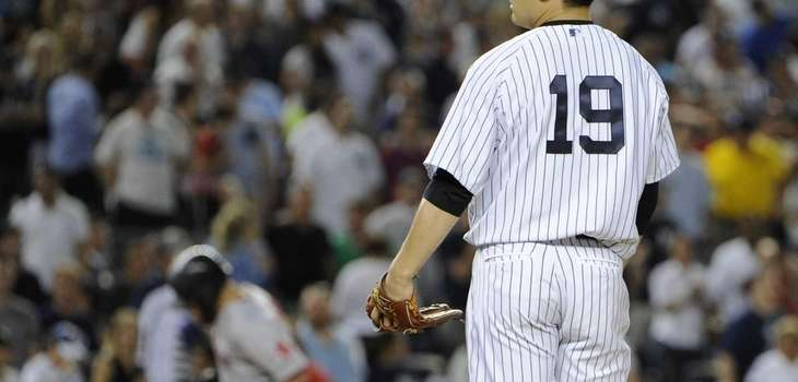 Yankees starting pitcher Masahiro Tanaka stands on the