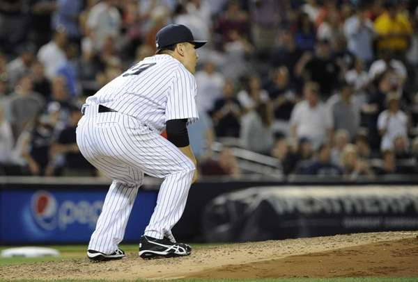 Yankees pitcher Masahiro Tanaka reacts on the mound