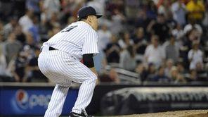 Yankees pitcher Masahiro Tanaka reacts on the mound