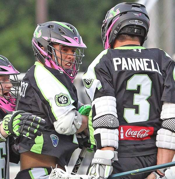 Lizards' JoJo Marasco and Rob Pannell celebrate Marasco's