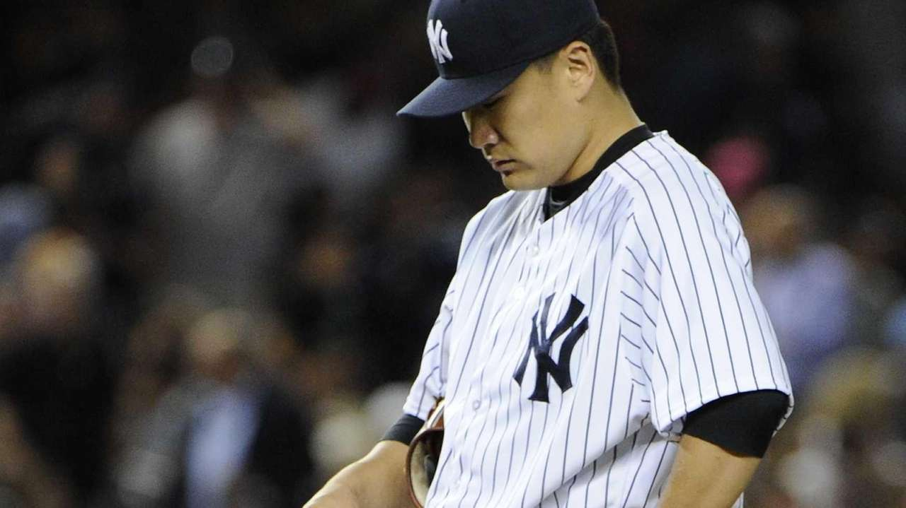 Yankees pitcher Masahiro Tanaka stands on the mound
