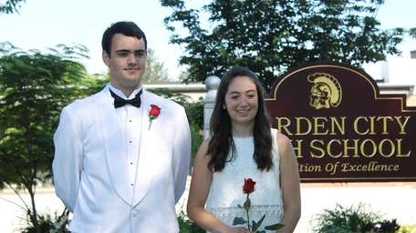 Valedictorian Steven Menelly and salutatorian Katherine McGannon outside