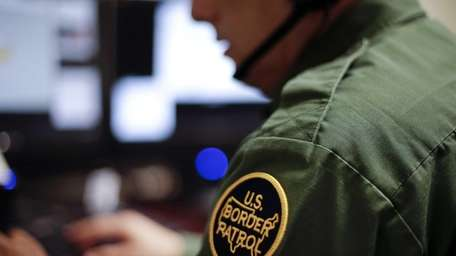A Border Patrol agent uses a headset and