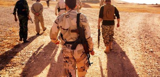 Kurdish Peshmerga soldiers keep guard near the front