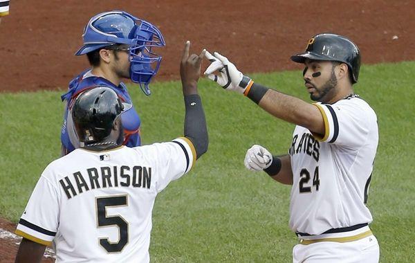 The Pittsburgh Pirates' Josh Harrison greets Pedro Alvarez