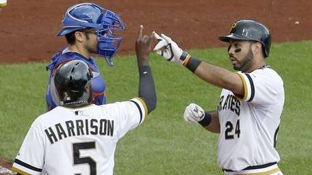 The Pittsburgh Pirates' Josh Harrison greets Pedro Alvarez