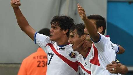 Costa Rica forward Bryan Ruiz celebrates with Costa