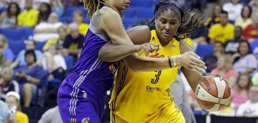 Tulsa Shock's Courtney Paris, right, is pressured by