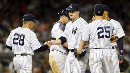 Shawn Kelley #27 of the Yankees hands the