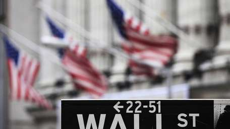 FILE: A Wall Street sign in front of