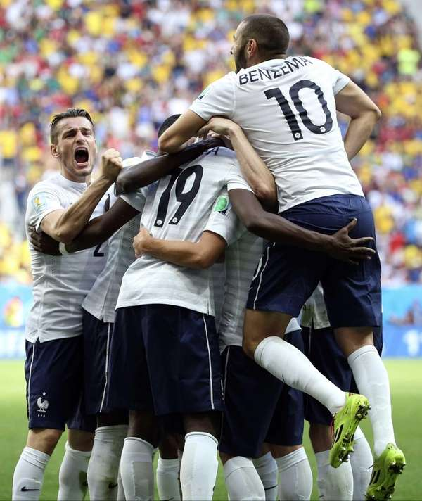 France's Paul Pogba celebrates with teammates after scoring