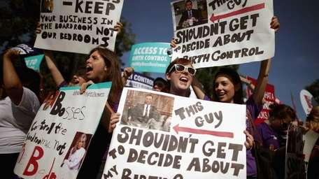 Supporters of employer-paid birth control rally in front