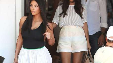 Kim Kardashian and Kourtney Kardashian step out for