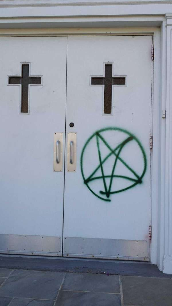 A pentagram scrawled on the front doors Bethel