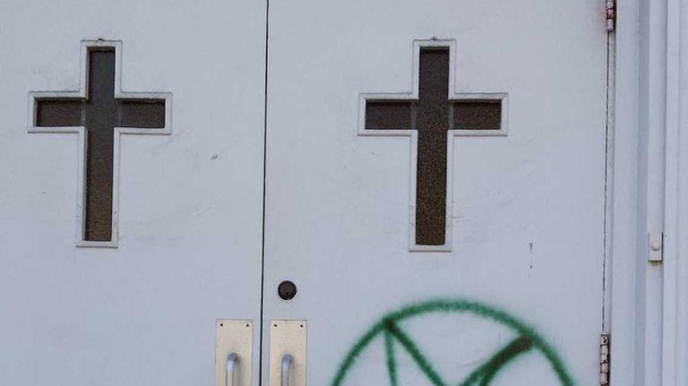 A pentagram scrawled on the front doors Bethel