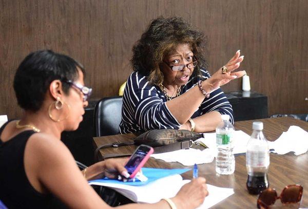 Hempstead school board president Betty Cross adjourns a