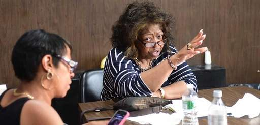 Hempstead school board president Betty Cross adjourns a