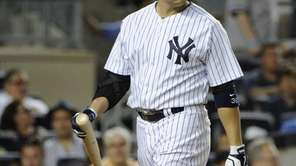 The Yankees' Carlos Beltran walks to the dugout