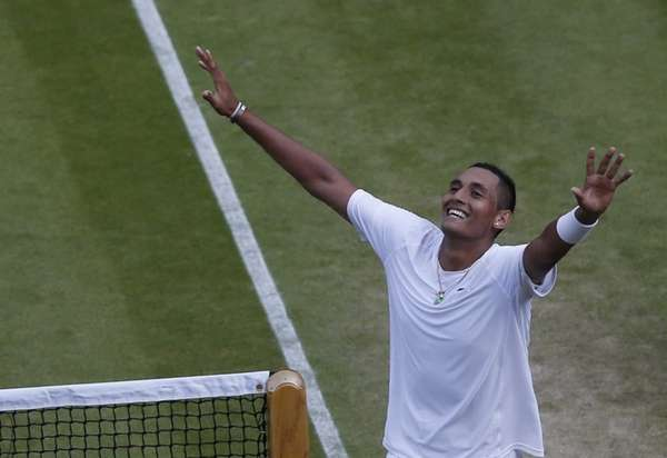 Nick Kyrgios of Australia celebrates defeating Rafael Nadal
