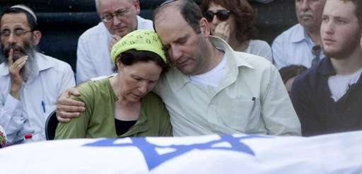 Avi and Rachel Fraenkel embrace during the funeral
