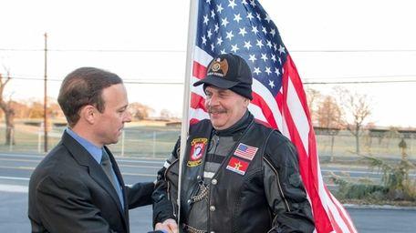 Islip Town Supervisor Tom Croci, left, greets American