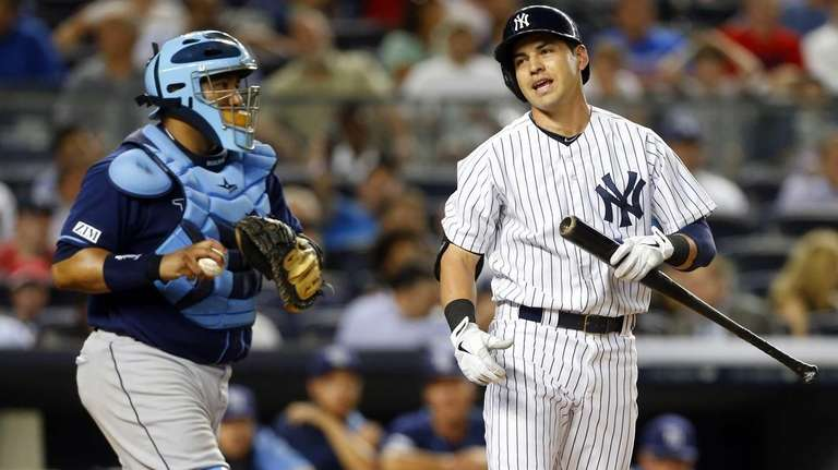 Jacoby Ellsbury of the Yankees reacts after striking