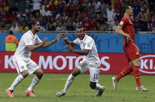 United States' Julian Green, center, celebrates after scoring