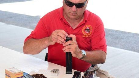 Nassau County Police Officer Thomas Jacobellis, a firearms
