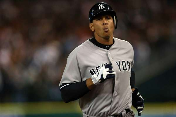 Alex Rodriguez walks off the field back to
