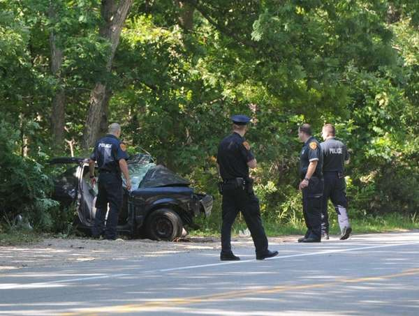 Police investigate the scene after a driver crashed