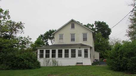 This antique Levittown Colonial has a large enclosed