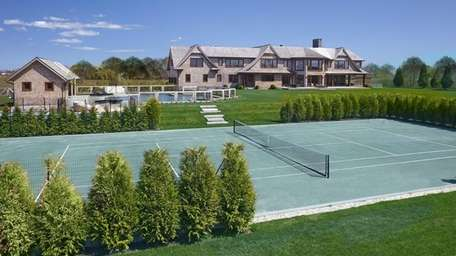Outside this Sagaponack home, listed for $22.995 million,