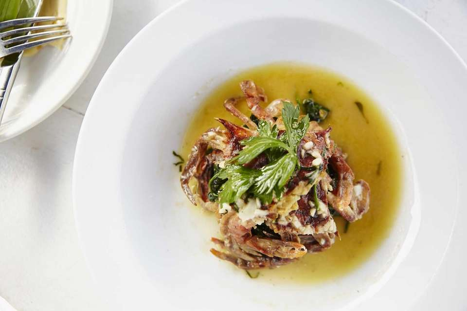 Soft-shell crab is served with lemon butter at